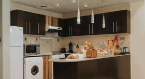 A kitchen or kitchenette at City Premiere Hotel Apartments