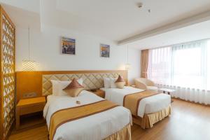 Кровать или кровати в номере TND Hotel