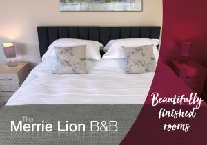 A bed or beds in a room at The Merrie Lion