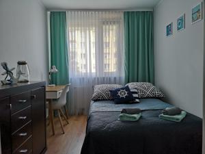 Postel nebo postele na pokoji v ubytování Apartament Anchor Przymorze