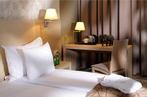 Cama o camas de una habitación en Rixwell Elefant Hotel with FREE Parking