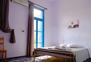 Ένα ή περισσότερα κρεβάτια σε δωμάτιο στο Merso