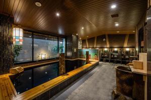 The swimming pool at or near Onyado Nono Asakusa Natural Hot Spring
