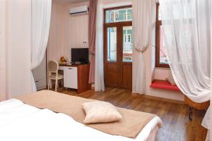 A bed or beds in a room at Hotel Nata