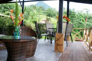 A restaurant or other place to eat at Arenal Waterfall Lodge
