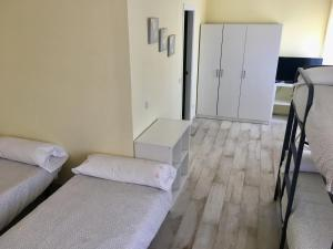 A bed or beds in a room at Llanes International Hostel
