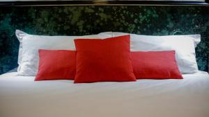 Un ou plusieurs lits dans un hébergement de l'établissement Hôtel Napoléon