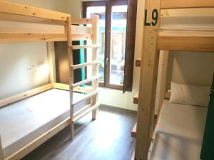 Una cama o camas cuchetas en una habitación  de SEÑOR OSO
