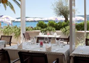 Restoran või mõni muu söögikoht majutusasutuses Hotel Palma