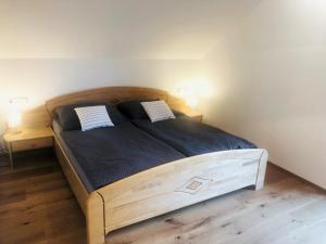 Ein Bett oder Betten in einem Zimmer der Unterkunft Feielhof