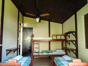 A bunk bed or bunk beds in a room at Chalés Aguaí