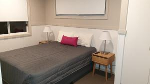 A bed or beds in a room at NRMA Victor Harbor Beachfront Holiday Park