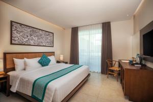 A bed or beds in a room at Anja Jimbaran
