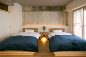 嵐山西超豪華公寓式酒店房間的床