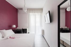 Кровать или кровати в номере Hotel Zenit Salento