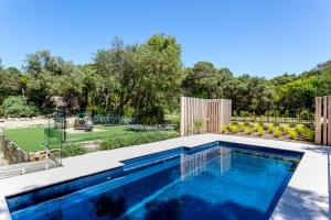 The swimming pool at or near The Retreat - Poolside Stunner at Rye Back Beach