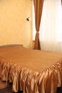 Кровать или кровати в номере Отель Этника
