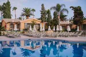 Piscina en o cerca de Suites & Villas by Dunas