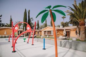 Zona de juegos infantil en Suites & Villas by Dunas