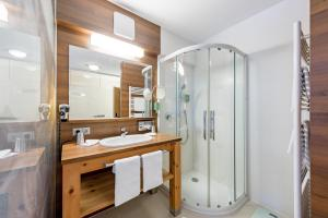 A bathroom at Hotel Andy 4 Sterne Superior