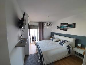 A bed or beds in a room at Appartement Prado Marseille Grand Pavois