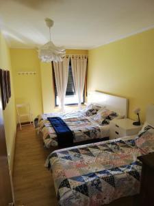 A bed or beds in a room at Apartamento Alcazar