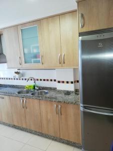 A kitchen or kitchenette at Apartamento Alcazar