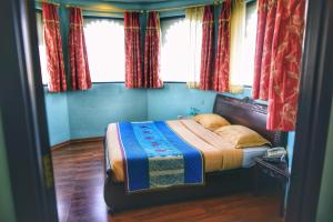 A bed or beds in a room at juSTa Lake Nahargarh Palace