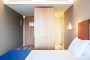Cama ou camas em um quarto em Ocean Drive Talamanca