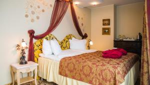 A bed or beds in a room at Grand Rose SPA Hotel