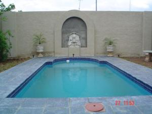 The swimming pool at or near Aa'Qtansisi Guesthouse