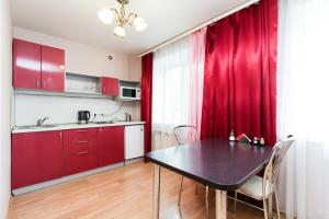 A kitchen or kitchenette at Avenu Hotel