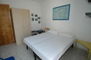 A bed or beds in a room at Residence Trande