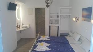 Ένα ή περισσότερα κρεβάτια σε δωμάτιο στο Augusta Studios & Apartments