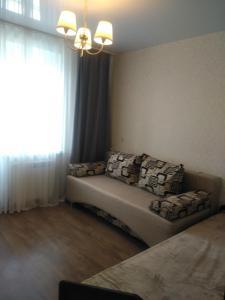 Гостиная зона в Apartment Stroiteley