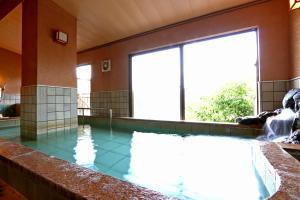The swimming pool at or near Hounkan