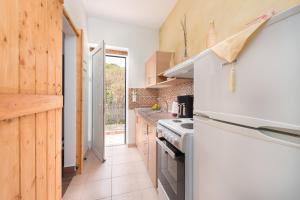 Cuisine ou kitchenette dans l'établissement Christos studios