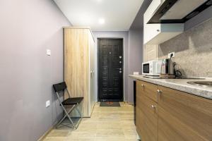 A kitchen or kitchenette at RentWill Borovskoe 137-1