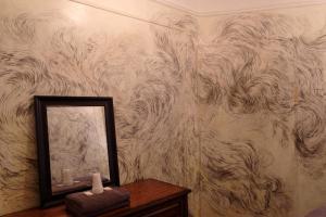 A bathroom at Carlton Arms Hotel