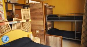 A bunk bed or bunk beds in a room at RESIDENCE SOLARIDE apartments, FREE PRIVATE PARKING WITH VIDEOSURVELLIANCE and SHUTTLE SERVICE