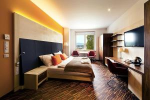 A television and/or entertainment center at Antonie Hotel****superior