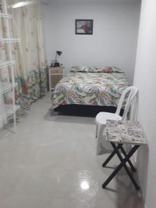 Ein Bett oder Betten in einem Zimmer der Unterkunft Posada Miss Portia