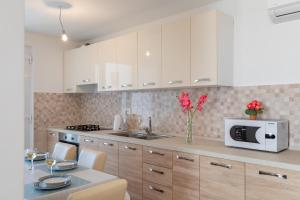 A kitchen or kitchenette at Apartment Nike