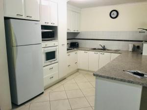 A kitchen or kitchenette at Sanctuary Beach Resort