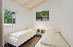 Ein Bett oder Betten in einem Zimmer der Unterkunft Ferienhausdorf Thale