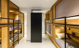 A bunk bed or bunk beds in a room at Mosaikon