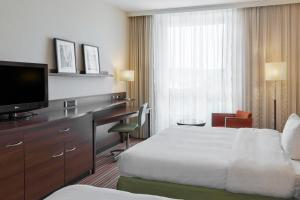 A bed or beds in a room at Courtyard by Marriott Basel