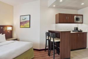 A kitchen or kitchenette at Courtyard by Marriott Basel