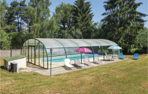 The swimming pool at or near Eight-Bedroom Holiday Home in Saint Dizier Leyrenne