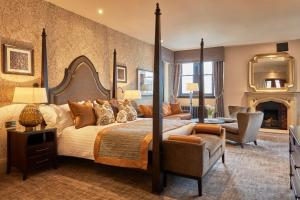 A bed or beds in a room at Stanbrook Abbey Hotel, Worcester